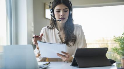 Woman wearing a headset while working at home