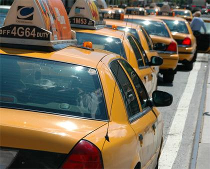 Lineup of yellow taxi cabs