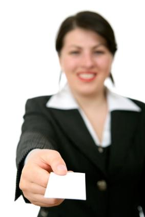 Female realtor offering a business card