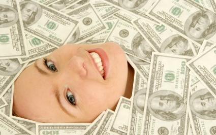 Female employee under a pile of bonus money