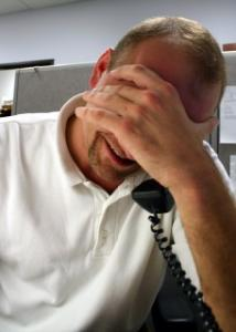 Stressed customer service rep talking on the phone