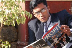 Business man reading Profit magazine