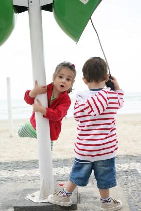 Two preschool children playing on the playground
