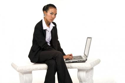 Female African American working on a laptop