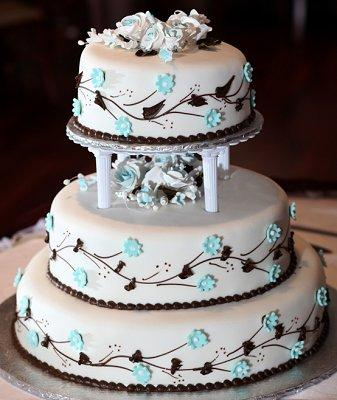 Wedding cake decorated with fondant flowers and vines & Fondant Cake Designs | LoveToKnow