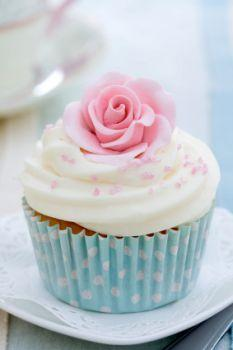 An edible flower on top of a cupcake
