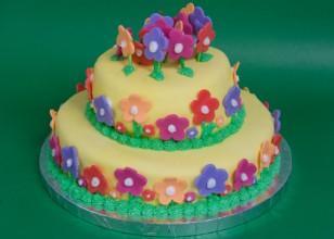 Flower fondant cutouts on cake