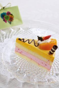 A slice of fruit on cake