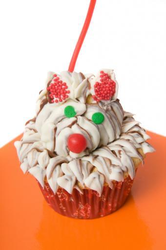 https://cf.ltkcdn.net/cake-decorating/images/slide/112630-565x850-Dog-Cupcake.jpg