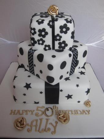 https://cf.ltkcdn.net/cake-decorating/images/slide/170414-450x600-50th-black-white-cake-flickr.jpg