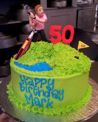 https://cf.ltkcdn.net/cake-decorating/images/slide/170878-482x600-50th-golfer-figurine-cake.jpg