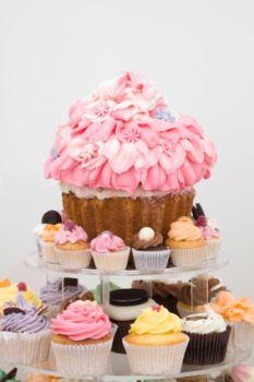 A giant cupcake cake with smaller cupcakes.