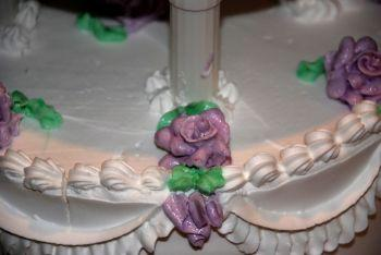 A buttercream rose on a wedding cake