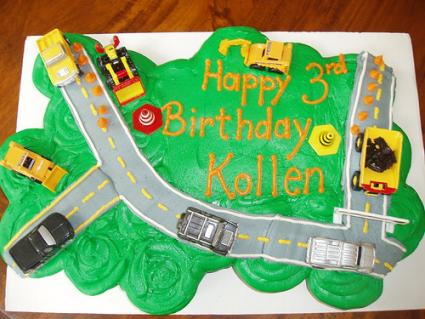 A cupcake cake with roads and vehicles