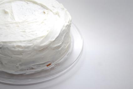 A cake with white frosting