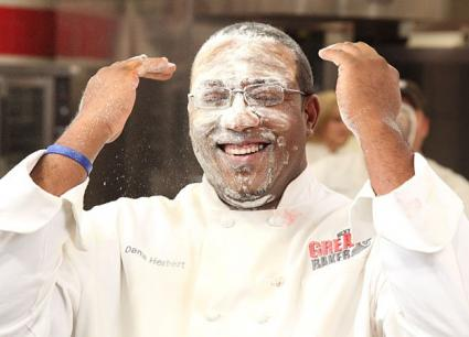Chef Dana Herbert covered in flour