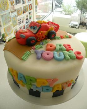 McQueen cake with fondant letters