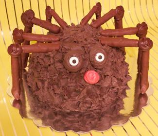Halloween spider cake with pretzel legs