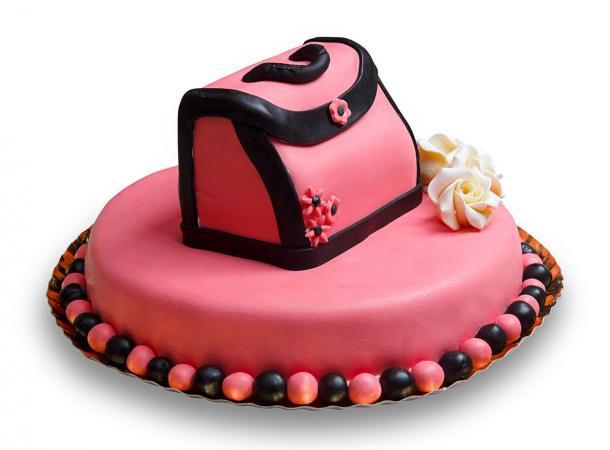 Pink purse cake topper