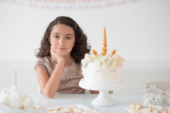 Birthday girl and unicorn cake