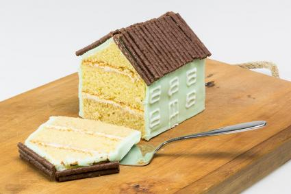 sliced piece traditional house shaped cake