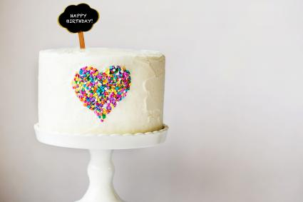 White cake with colourful heart design