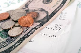 Restaurant bill with dollar bills