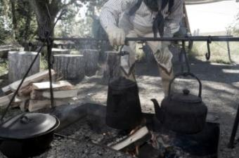 cowboy cooking on a campfire
