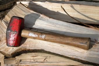 Sledgehammer on split wood