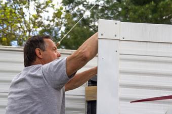 Man repairing camper