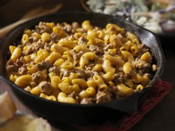 Chili mac and cheese in iron skillet