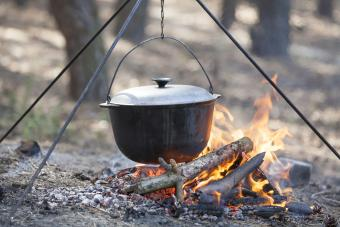 Dutch oven hanging over campfire