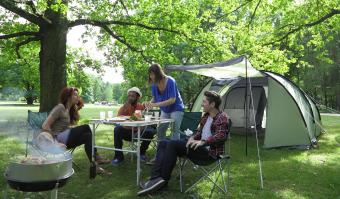 young adults out camping