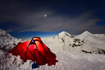 Red tent in snowy mountains