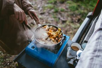 Making food on camping stove in nature