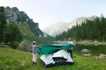 Father and son pitching tent together