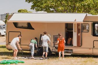 Family camping at trailer park