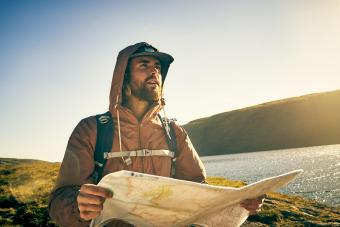 hiker looking at a map while out in the mountains