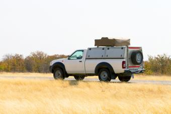 Pickup truck with rooftop tent driving