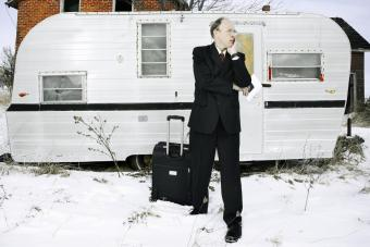 Man outside with an abandoned trailer