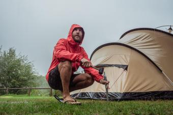 Man caught in a rainstorm while camping