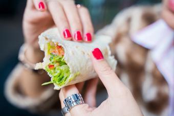 Woman eating a wrap