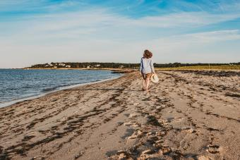 woman walking on Cape Cod beach
