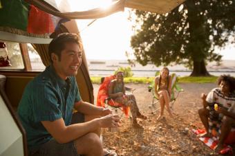 Friends relaxing by camper van