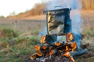 Backpacking pot over open fire