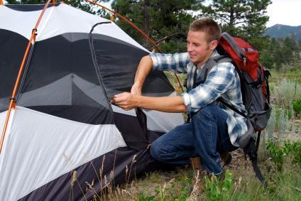 Camper pitching tent