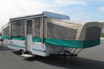 popup trailer at a campsite