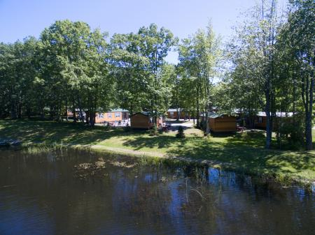 Riverside cabins at Bayley's Camping Resort