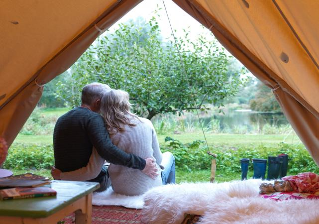 Couple sitting in luxury tent