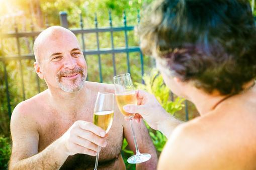 nudists toasting outside